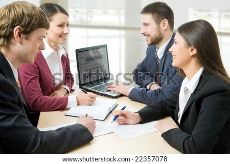 Four all-sufficient business people work in team