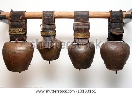 Four antique bells on balk in switzerland museum in Appenzell
