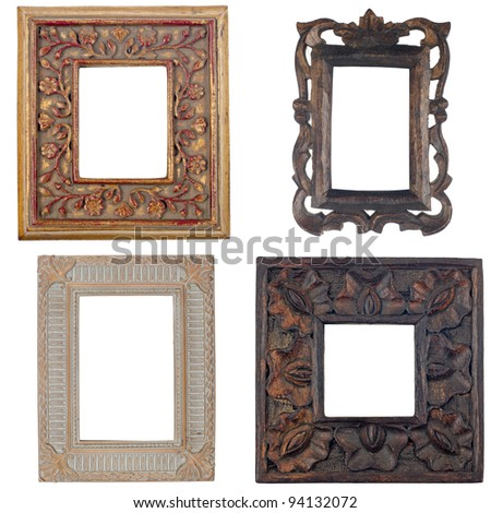 Four antique picture frames isolated on white background.
