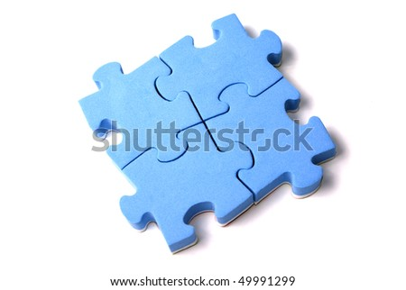 Four attached blue puzzles isolated over white