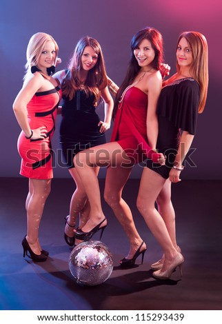 Four attractive females with disco ball at the club