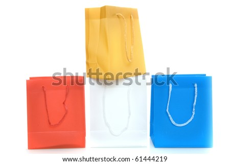 four bags in the dutch colors, red, white, blue and orange