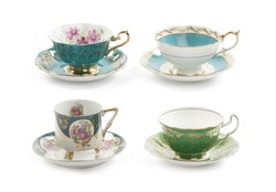 Four beautiful vintage tea cups with saucers isolated on a white background.