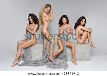 Four beautiful women on concrete block