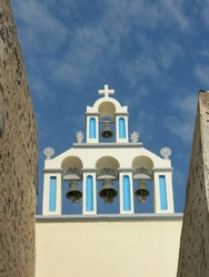 Four bells in church belltower in Fira, Santorini, Greece