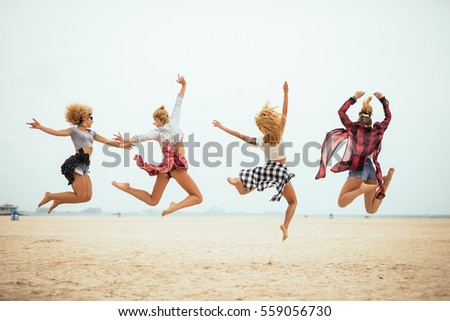 Four best friends having fun on a sunny day on the beach. #559056730