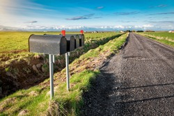 four black mailboxes, letterbox near the farm