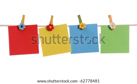Four blank notes hanging on the clothesline isolated on white background