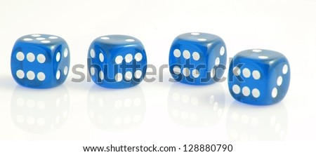 four blue dice showing the number six, symbolizing luck