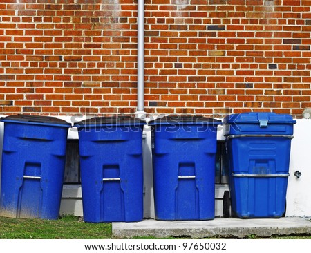 stock-photo-four-blue-plastic-trash-cans