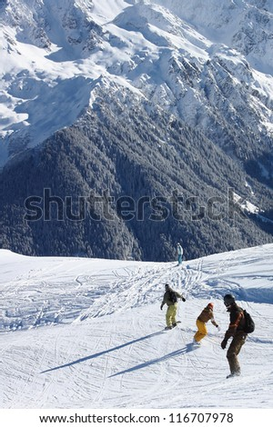 Four boarders riding freeride to the horizon