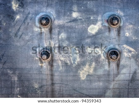 Four bolts on a corroded metal background.  Great as a background or for texture use.