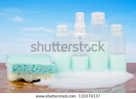 Four bottles of soap with bubbles and sponge