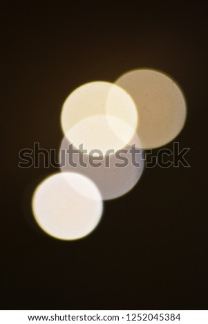 four bright blurry circles overlapping against dark background, design element #1252045384