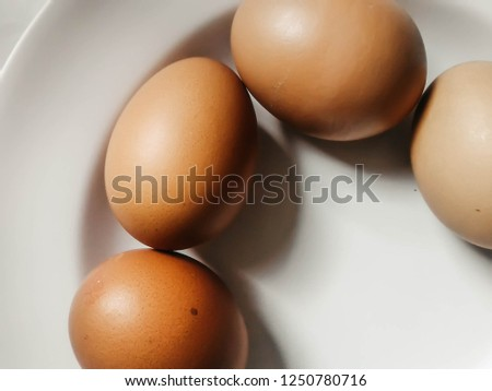 four brown egg on dish #1250780716