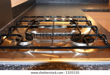Four burner gas hob in a modern fitted kitchen