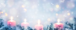 four burning advent candle lights border on abstract empty background, xmas lights with christmas fir deco background concept