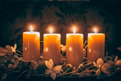 four burning candles with traditional festive cristian atmosphere full of light and magic