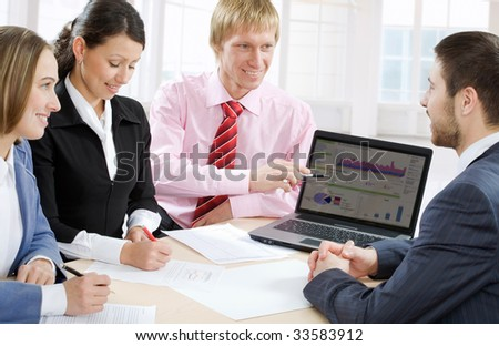 Four business people work