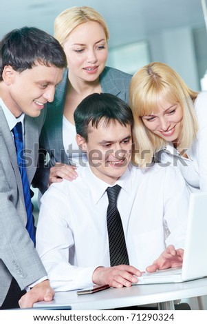 Four business people working in office