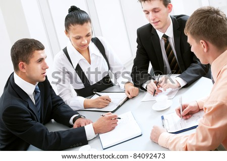 Four business people working together at office - stock photo