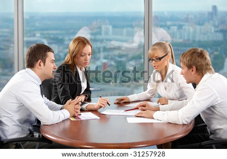 Four businessmen are engaged in negotiations at office