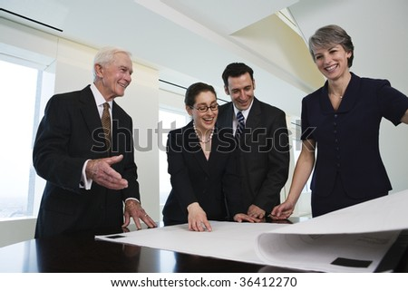Four businesspeople discussing successful plan - stock photo