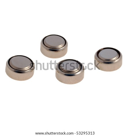 Four button cell batteries against a white background