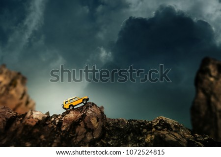 Four by four off road car crossing through the country road. Travel and racing concept for four wheel drive off road vehicle . #1072524815