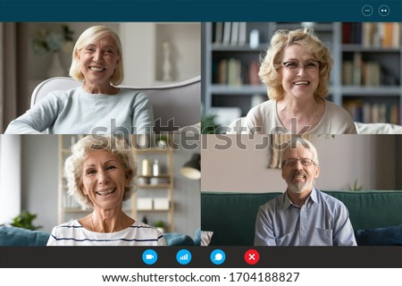 Four Caucasian middle-aged 50s people involved at group video call conference, laptop webcam head shot portraits view. Older generation and modern application technology easy convenient usage concept