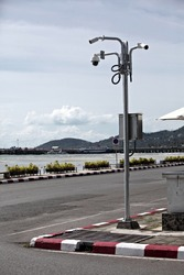 Four cctv cameras on steel pole with blue sky background at street corner of Nathon town on the island of Koh Samui in Thailand