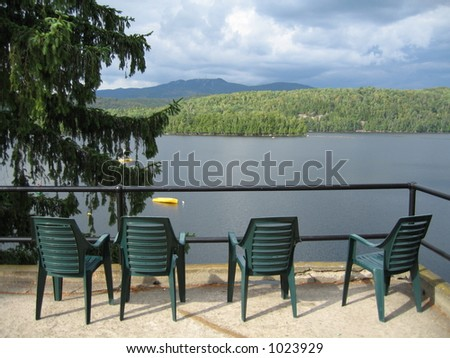 four chairs by a lake