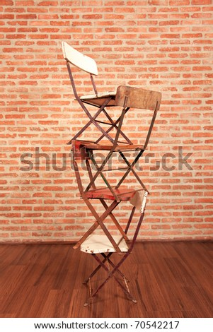 Four chairs stack on together.