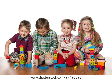 Four children are playing on the floor together; isolated on the white background