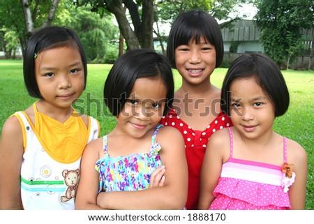 Four children having good time in the park.