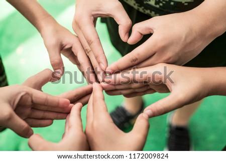 Four Chinese children make love heart gestures #1172009824