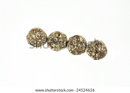 Four chocolate truffles isolated on white