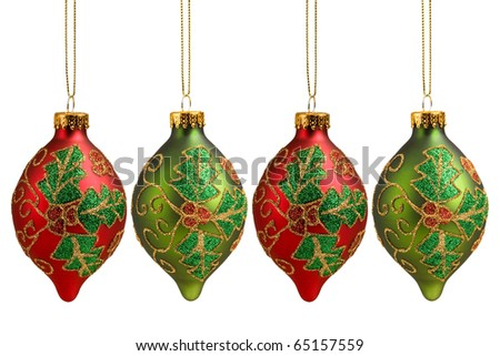 Four Christmas baubles with Christmas holly pattern isolated on white background for holiday decoration.