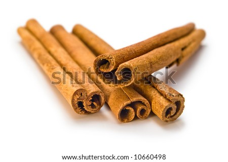four cinnamon spice sticks on white background