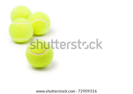 Four classic tennis balls isolated on white background