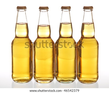 Four clear beer bottles on white background.