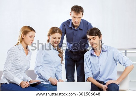 Four co-workers discussing business ideas in office #301506848