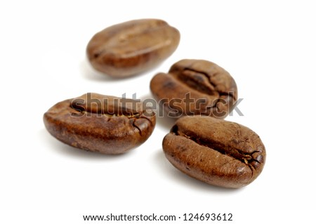 Four coffee beans on white background