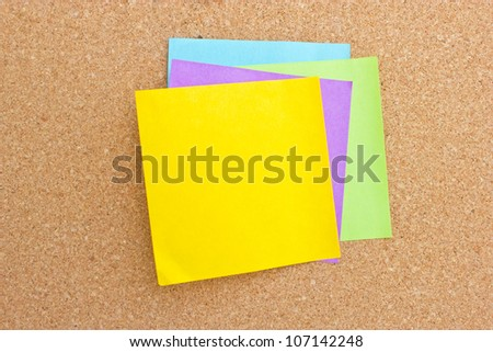 Four color sticky note on board.