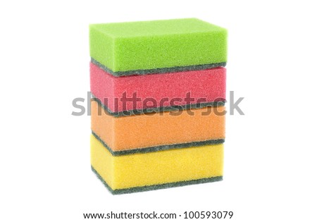 Four colored scouring sponges on the white background