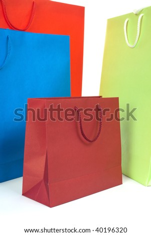 Four colorful gift paper bags on white background