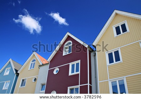 Four colorful houses with blue sky