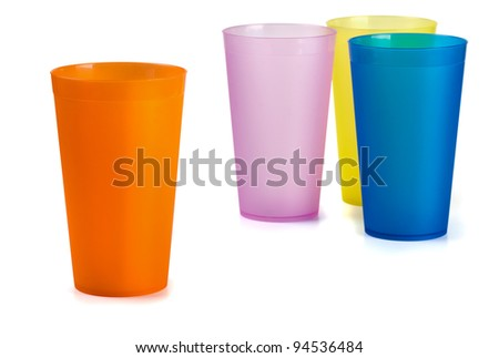 Four colorful plastic cups isolated on  white