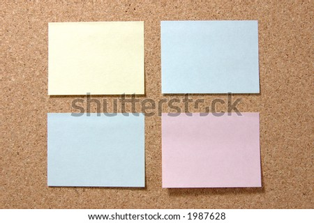 Four colorful post-it notes on corkboard