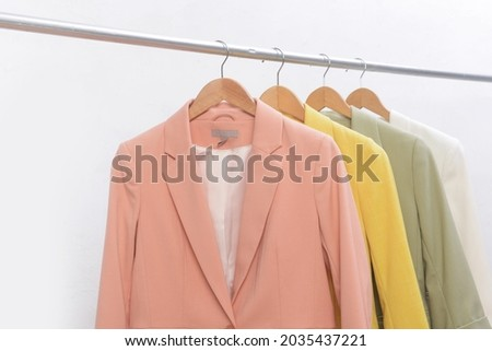 Four colorful suit jacket r on hanger on white ,background. Stock fotó ©